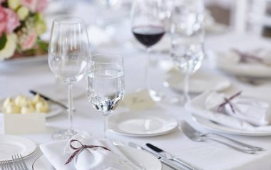 Close-up image of a table on a festive event, party or wedding reception. Preparation for the reception of guests.