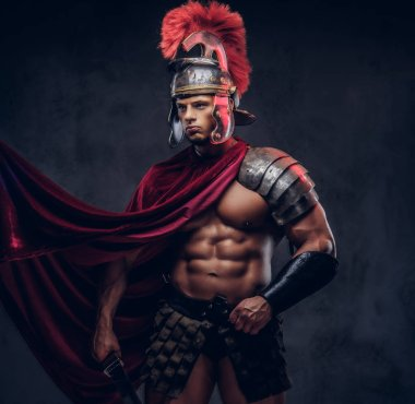 Portrait of a brutal Roman legionary in battle uniforms on a dark background.