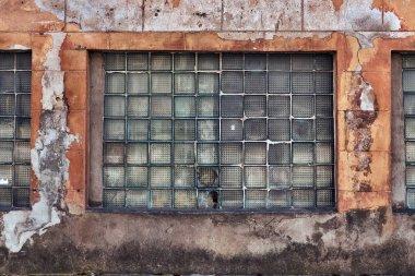 Industrial background. Grunge urban street with warehouse brick wall.