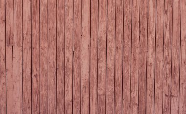 Vintage wood background. Pink painted an old wooden background.