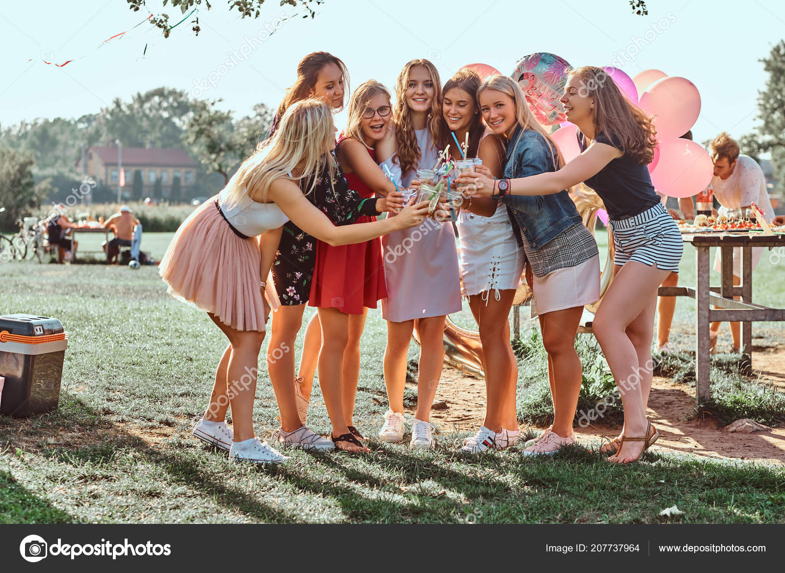 Group Of Girlfriends Having Fun Together Celebrating A Birthday At
