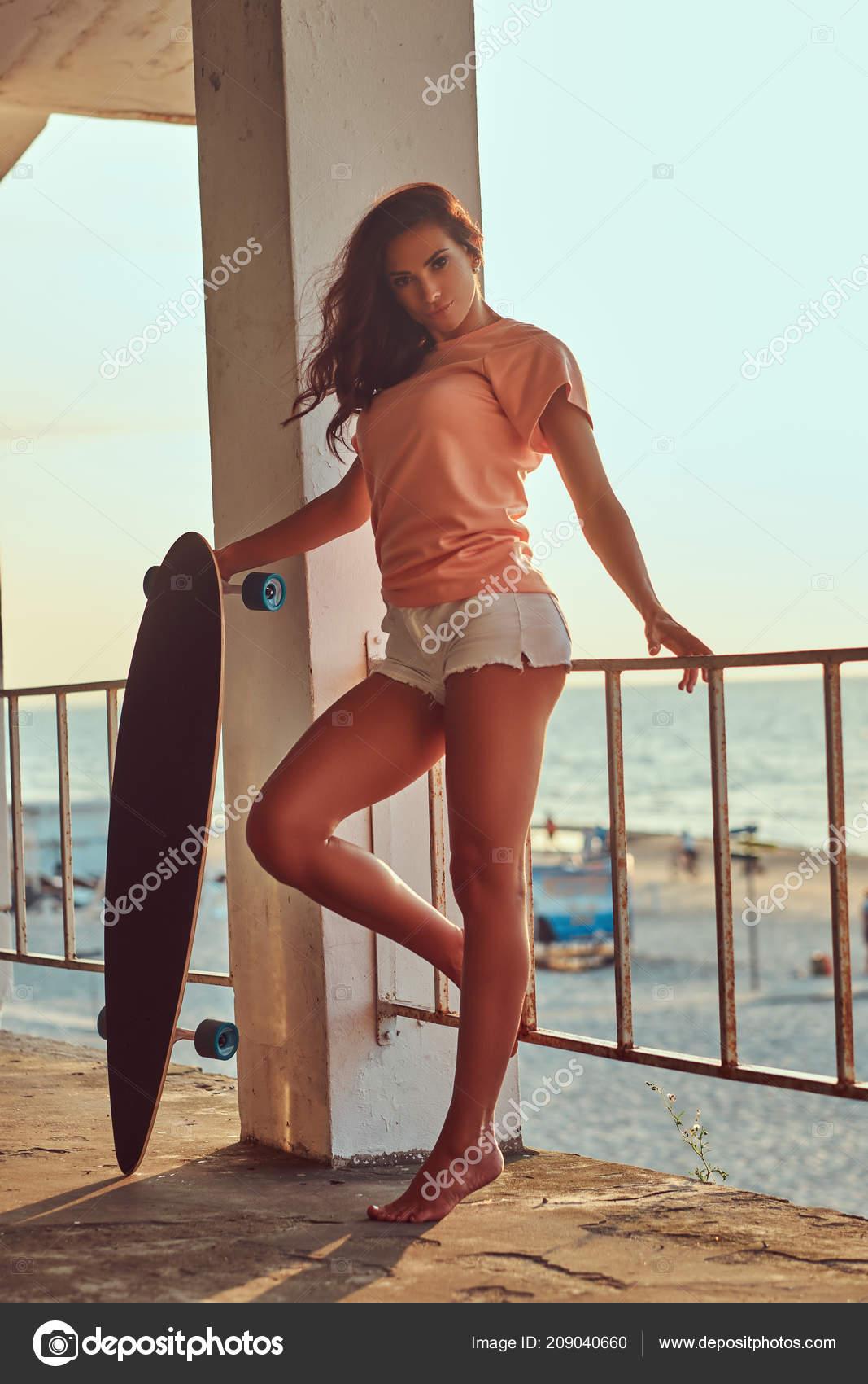 https://st4.depositphotos.com/1001959/20904/i/1600/depositphotos_209040660-stock-photo-seductive-brunette-woman-dressed-shirt.jpg