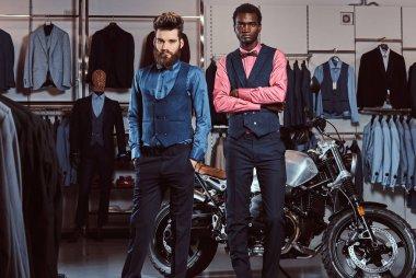 Two stylish elegantly dressed men posing near retro sports motorbike at the mens clothing store. stock vector