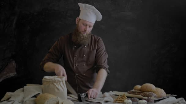 Chef sharpen knife and slice bread into pieces