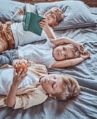 Preschool children resting and learning books in playschool