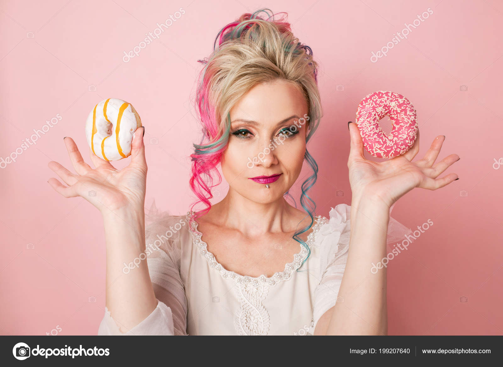Stylish And Beautiful Woman With Colored Hair With Two Donuts