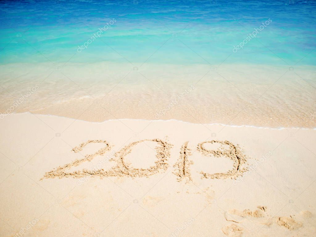 New 2019 year in the South, the sea. Inscription on the sand, celebrate the new year in the tropics. New year holidays