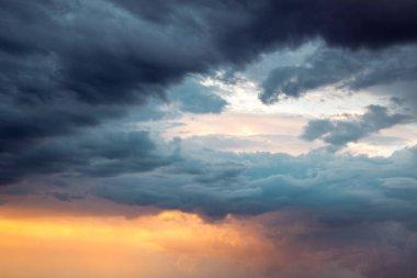 Dramatic sky after rain. Rays of light through dark clouds