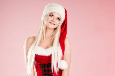 Cute and attractive blonde woman in a Santa suit.