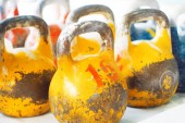 Photo Multicolor kettlebells on gym.  Work out with kettlebells