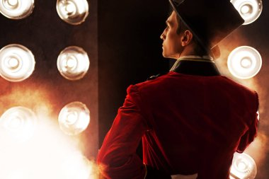 Showman. Young male entertainer, presenter or actor on stage.