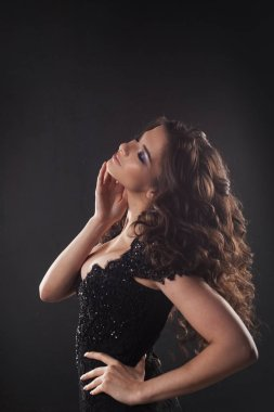 Portrait of a young attractive woman with gorgeous curly hair. Attractive brunette.