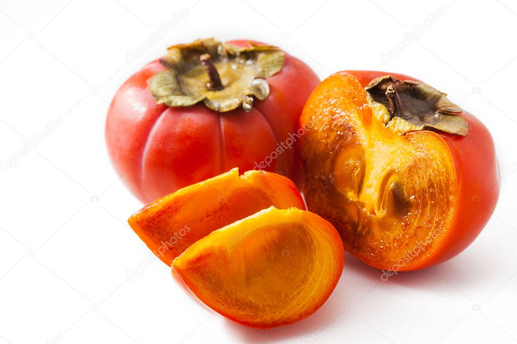 Fresh juicy persimmon isolated on white background.