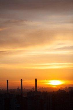 Three chimneys at sunset, city landscape