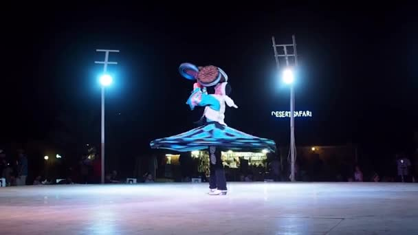 DUBAI, UNITED ARAB EMIRATES, MAY 2, 2018: Dance show. Dance in the style of dervishes. A man in a blue suit turns