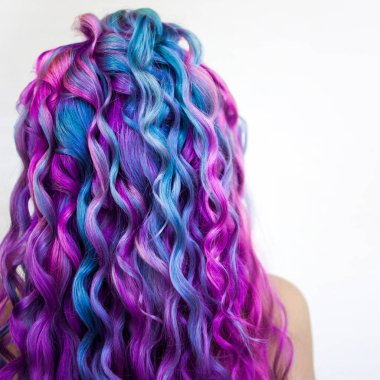 Bright multi-colored hair coloring, gradient blue purple and pink shades. Beautiful hair