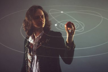 Physics the science of nature, the concept of studying the laws of nature. A young man in the image of Isaac Newton.