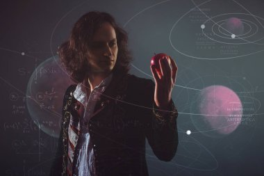 History of science, concept. Isaac Newton with Apple in hand