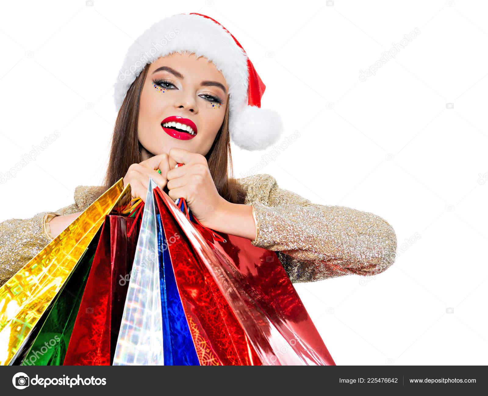 64da4c6048149 Woman Santa Hat Holding Colorful Shopping Bags Looking Away — Stock Photo