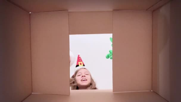 Family opening cardboard box