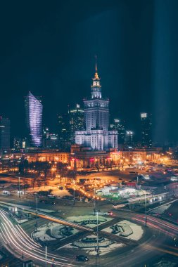 Warsaw, Poland, February 24, 2018: view of the city center from the window of the Novotel hotel late at night, outside the winter evening and car traffic, view of the Palace of Culture and Science