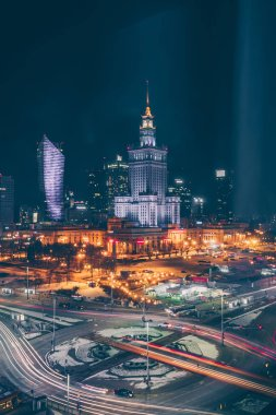 Warsaw, Poland, February 24, 2018: view of the city center from the window of the Novotel hotel late at night, outside the winter evening and car traffic