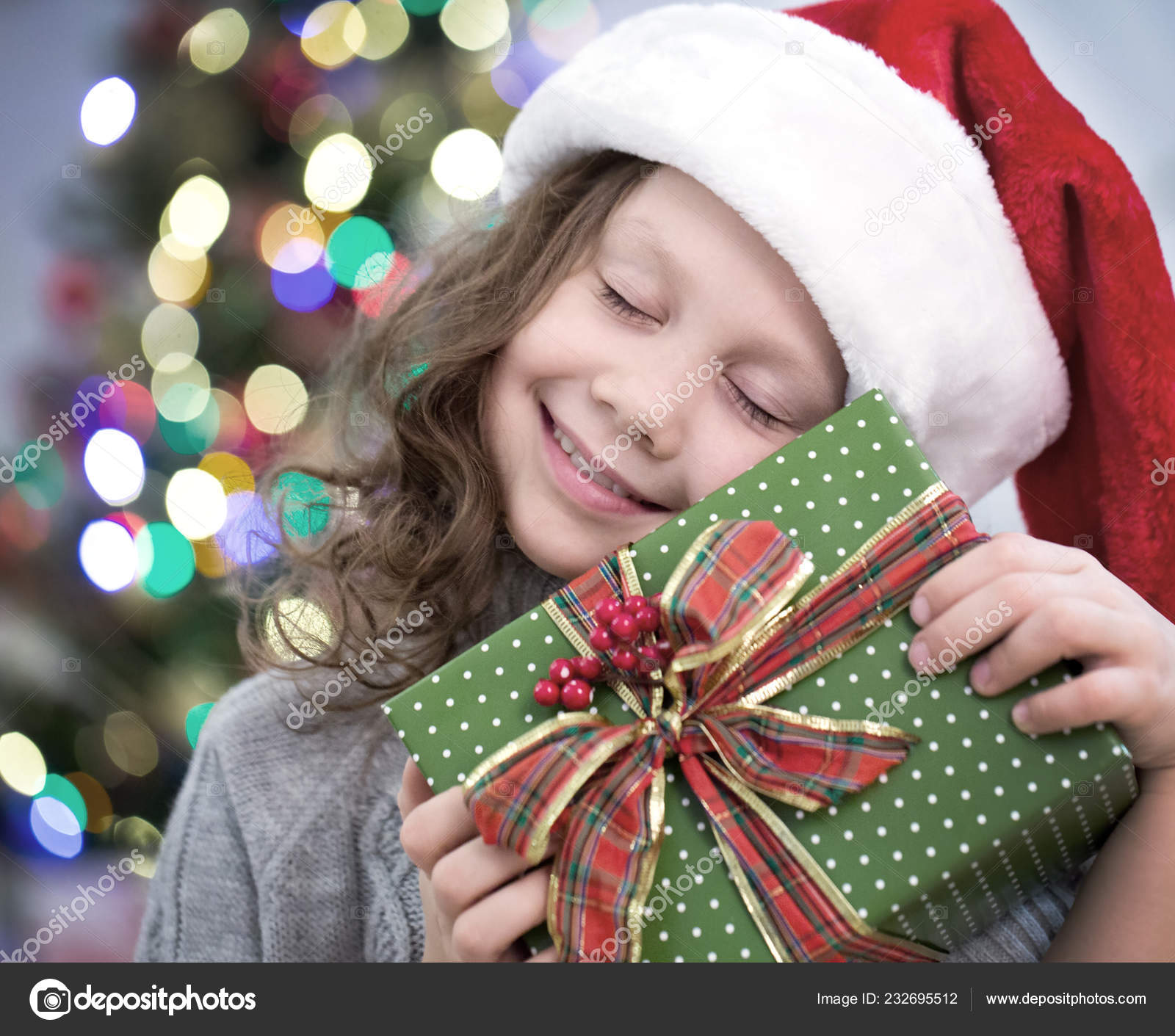 801a00d8049a1 Little Girl Santa Hat Holding Present Christmas Tree — Stock Photo ...