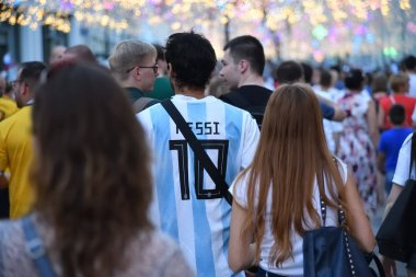 Moscow, Russia - June 23, 2018: World Cup 2018, football fans on the streets of Moscow. Soccer fan from Argentina in national national team form number 10  Lionel Messi walking down the Nikolskaya street and go away. Mundial 2018