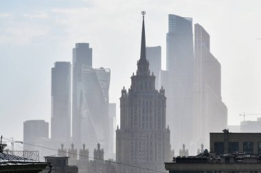 Moscow skyline. Stalinist skyscraper on the background of the Moscow City business centre skyscrapers shown after summer rain. Capital of Russia