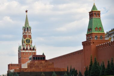 Moscow Kremlin wall with the Spasskaya Tower and Lenin's Mausoleum on Red Square in summer day. Architecture and landmarks of Moscow, Russia