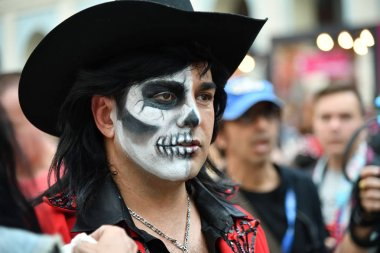 Moscow, Russia - June 29, 2018: Man in hat with sugar skull makeup during Dia de los Muertos Mexican carnival. Day of The Dead