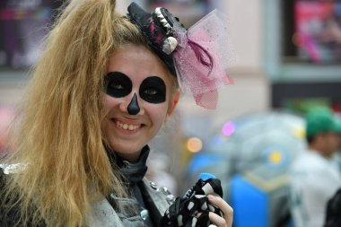 Moscow, Russia - June 29, 2018: Woman with skull makeup during during Dia de los Muertos Mexican carnival. Day of The Dead