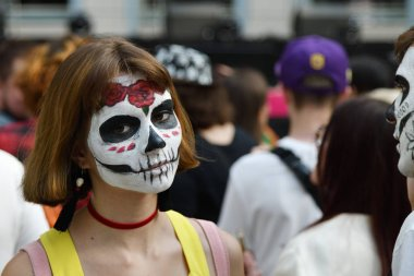 Moscow, Russia - June 29, 2018: Woman with sugar skull makeup during Dia de los Muertos Mexican carnival. Day of The Dead
