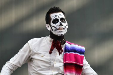 Moscow, Russia - June 29, 2018: Man in sugar skull makeup during Dia de los Muertos Mexican carnival. Day of The Dead