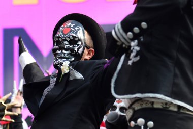 Moscow, Russia - June 29, 2018: Man in hat with sugar skull mask during Dia de los Muertos Mexican carnival. Day of The Dead