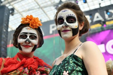 Moscow, Russia - June 29, 2018: Girls with sugar skull makeup during Dia de los Muertos Mexican carnival. Day of The Dead