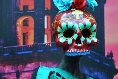 Moscow, Russia - June 29, 2018: Participant in skull mask dressed traditional clothing during Dia de los Muertos Mexican carnival. Day of The Dead
