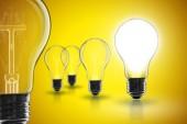 Fotografie Idea and  leadership concept -  incandescent light bulb on the black background