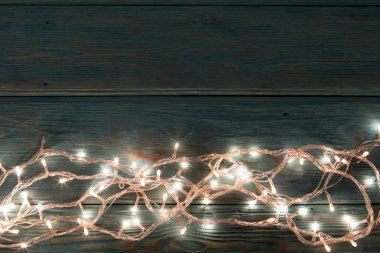 Christmas rustic background - vintage planked wood with lights and free text space stock vector