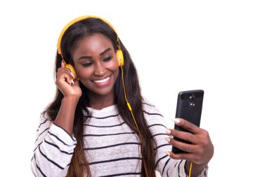 Beautiful young african woman listening to music, isolated over white