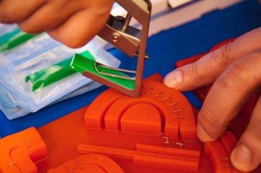 Demonstration of modern medical skin stapler on silicon sample