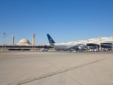 Riyadh - March 01:  Planes preparing for take off at Riyadh King Khalid Airport on March 01, 2016 in Riyadh, Saudi Arabia. Riyadh airport is home port for Saudi Arabian Airlines. stock vector