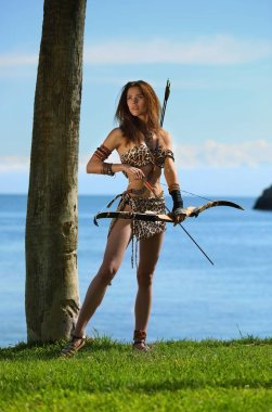 A young beautiful girl with a bow and arrows