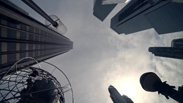 skyscrapers and famous globe on blue sky background