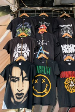 ATHENS, GREECE - AUGUST 29, 2018: T-shirts printed with rock band designs. Pop music merchandise.