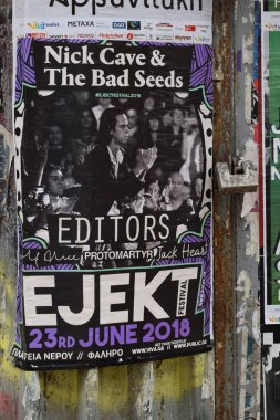 ATHENS, GREECE - APRIL 11, 2018: Nick Cave And The Bad Seeds concert poster on rusty fence.
