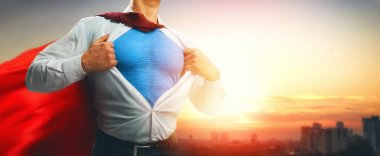 superhero businessman looking at city skyline at sunset. the concept of success, leadership and victory in business.