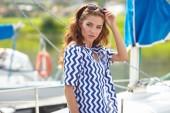 Fotografie Beautiful woman on a sailing boat