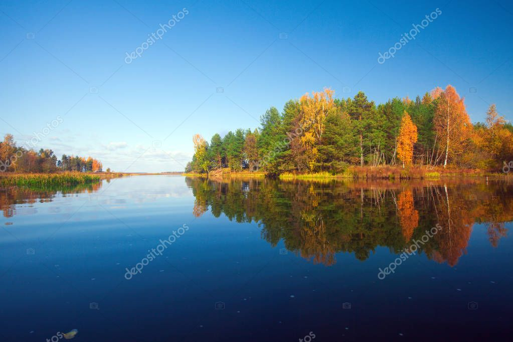 scenic view of autumn island and lake