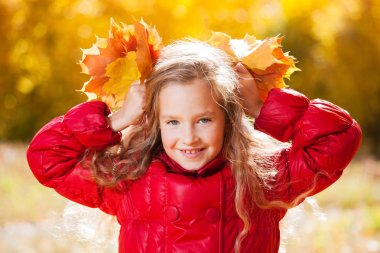 Girl at autumn. Child with leaf at park stock vector